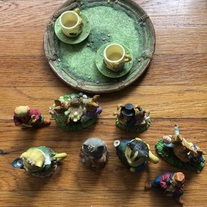 cute tea set with multiple bear and cat figurines